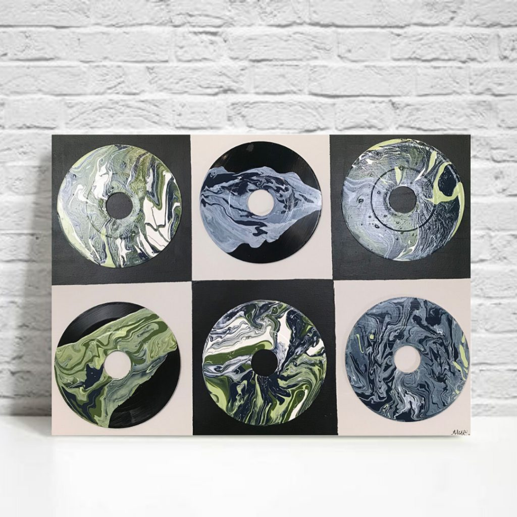 Displaying local artists paintings on vinyl records
